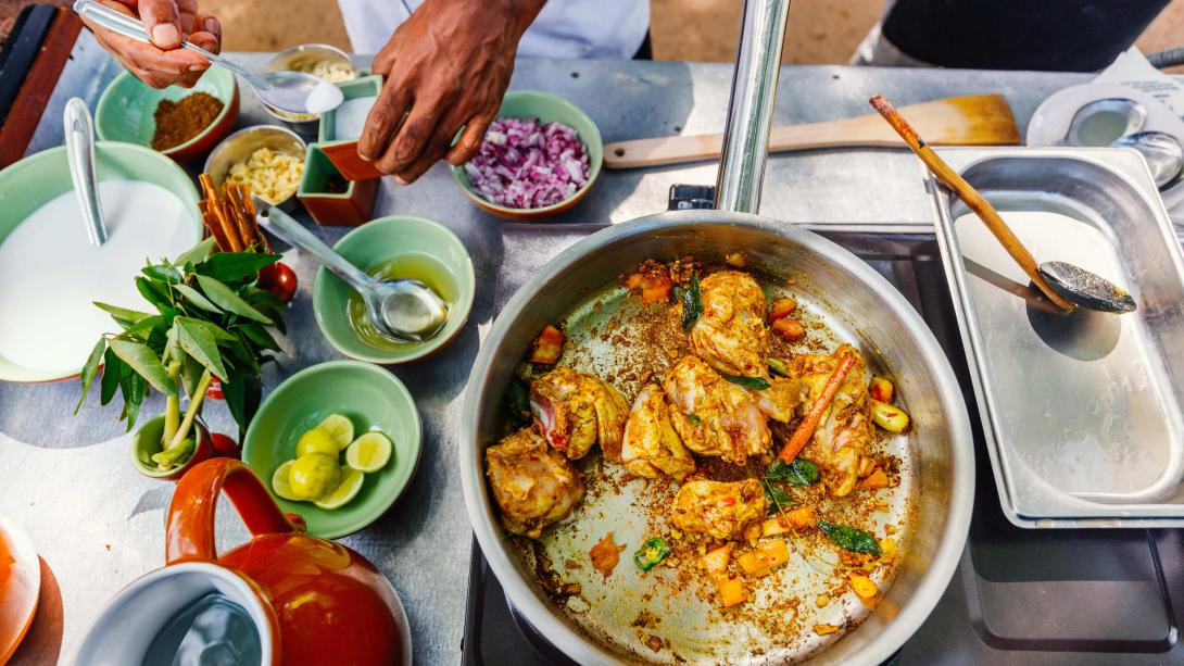 Travellers learn how to cook traditional Sri Lankan food during their Discovery Tour.